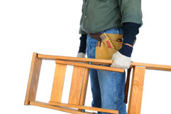 Construction Worker Carrying Ladder Royalty Free Stock Images