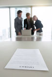 Closeup of a contract on office desk Royalty Free Stock Image