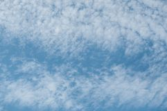 Contrail in a blue sky Stock Photos