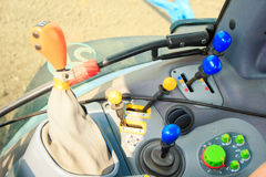 closeup control sticks on instrument panel in tractor cabin Stock Image