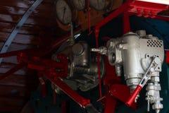 Closeup control valve of steam locomotive. Directional valves allow steam to flow through the steam locomotive engine drive system. Railway transportation stock image