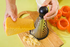 Closeup of cook grating cheese. Stock Image
