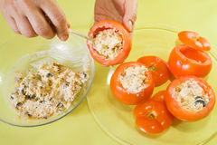 Closeup of cook stuffing tomato salad Stock Image