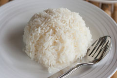 Closeup cooked rice. On white dish Stock Photo
