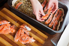 Closeup of cooking fish pie with salmon. In baking sheet Royalty Free Stock Photo