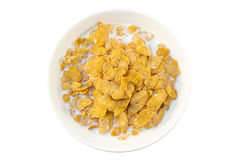 Closeup of corn flakes and milk in a bowl viewed from above Stock Photography