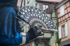 Closeup of Costumed woman with fan at the Venetian Parade in Riquewihr in Alsace. RIQUEWIHR - France - 1 July 2017 - closeup of Costumed woman with fan at the Stock Images
