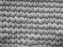 Closeup cotton grey knit blanket, warm and comfortable atmosphere. Knit background.  royalty free stock images