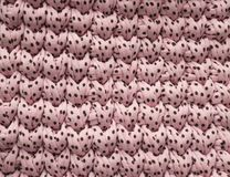 Closeup cotton pink dots knit blanket, warm and comfortable atmosphere. Knit background.  royalty free stock photo
