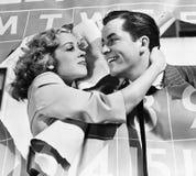 Closeup of couple bursting through calendar Royalty Free Stock Images