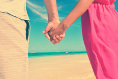 Closeup Of Couple Holding Hands At Beach Stock Image