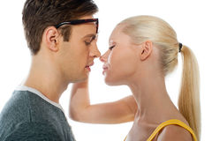 Closeup of couple kissing. Each other on white background Royalty Free Stock Photos
