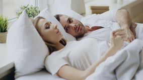 Closeup of couple with relationship problems having emotional conversation while lying in bed at home. Closeup of couple with relationship problems having Royalty Free Stock Photos