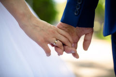 Closeup of a couple's hands on a walk. Closeup, happy couple holding hands Stock Photo