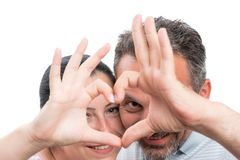 Closeup of couple showing heart symbol royalty free stock photo