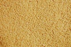 Closeup of couscous. Closeup of yellow couscous groats royalty free stock photography