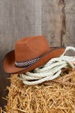 Closeup cowboy hat and ropes Royalty Free Stock Photo