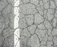 Closeup of cracked asphalt road Stock Image