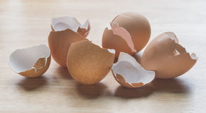 Closeup cracked eggshells. On wooden board Royalty Free Stock Image