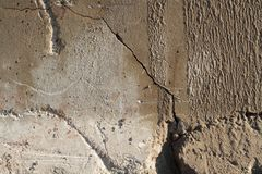 Closeup of cracked textured concrete wall Stock Photo