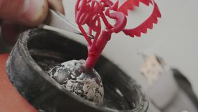 Closeup. Creating wax molds for production of jewelry. Goldsmith in work. Soldering tool for melt waxy. Creation