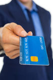 Closeup on credit card in hand of business woman Royalty Free Stock Photography
