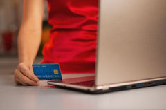 Closeup on credit card in hand of woman making online purchases Stock Photo
