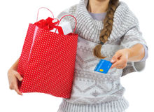 Closeup on credit card in hand of woman with shopping bag Stock Photos