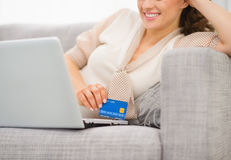 Closeup on credit card in hand of woman Royalty Free Stock Photography