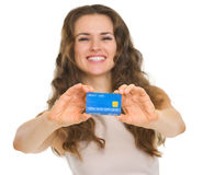 Closeup on credit card in hands of happy woman Royalty Free Stock Image