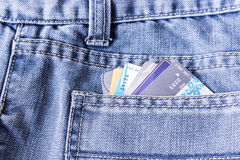 Closeup of credit card in jeans trousers pocket Stock Photos