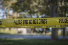 Closeup of crime scene tape. Crime scene tape marked police line do not cross to secure a scene from public access Stock Photos