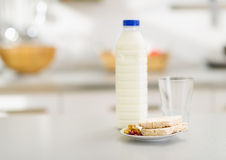 Closeup on crisp bread and milk on table in kitchen Stock Images
