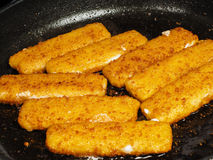 Closeup of crispy breaded fish fingers Stock Photography