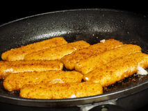Closeup of crispy breaded fish fingers Stock Photo