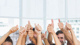 Closeup of cropped people gesturing thumbs up Stock Images