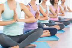 Closeup of cropped sporty women with joined hands Stock Image