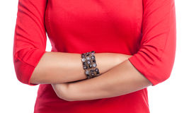 Closeup on crossed hands of business woman. Wearing a red dress. White isolated background royalty free stock photo