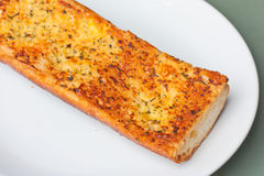 Closeup of crunchy garlic bread Stock Images