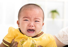 Closeup crying asian baby Stock Photo