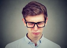 Closeup of a crying teenager man. In glasses Stock Images
