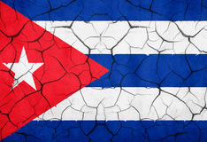 Closeup of cuban flag broken crack wall with rift, communist dictatorship. Pray for president concept royalty free stock images