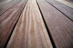 Closeup of cumaru hard wood. Suitable for decking or flooring. Cumaru, or cumaro, origins from South America. Its seeds are known as tonka beans. The wood is Royalty Free Stock Image