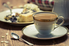Closeup of a cup of coffee and poppy seed cake Royalty Free Stock Photos