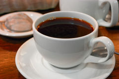 Closeup of cup of dark tea on table Stock Photography