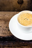 Closeup cup of espresso on old wooden table over grunge background, top view stock photos