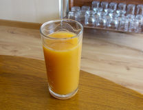 Closeup of a cup with orange juice Stock Images