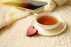 Closeup of cup of tea and red heart Stock Photo