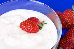 Closeup Of Cup With Yoghurt And Strawberries Royalty Free Stock Photography