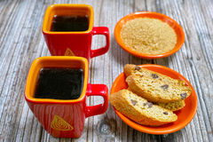 Closeup cups with espresso coffee, raw brown sugar and amandel c Stock Images
